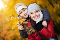 Happy Mom with son in a yellow autumn park Stock Photography