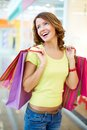Happy moment young shopper being with her purchases and herself Stock Images