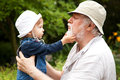 Happy moments grandchild and grandfather having fun outdoors Royalty Free Stock Photography