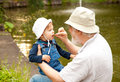 Happy moments grandchild and grandfather having fun outdoors Stock Images