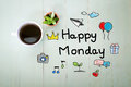 Happy monday message with a cup of coffee on pastel green wooden table Royalty Free Stock Photo