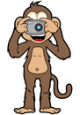 Happy Monkey with camera Royalty Free Stock Photography