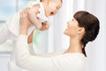 Happy mother with adorable baby picture of focus on woman Royalty Free Stock Photo