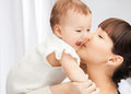 Happy mother with adorable baby picture of focus on woman Royalty Free Stock Photography