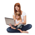 Happy mother with adorable little girl and laptop Royalty Free Stock Photography