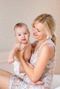 Happy mother with baby boy indoors Royalty Free Stock Images