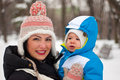 Happy mother and baby boy in winter holding park Royalty Free Stock Photography