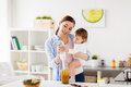 Happy mother and baby cooking food at home kitchen Royalty Free Stock Photo