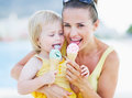 Happy mother and baby eating ice cream young girl Royalty Free Stock Photography