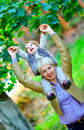 Happy mother and baby girl having fun in park colorful Stock Photography