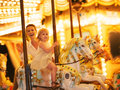 Happy mother and baby girl riding on carousel Royalty Free Stock Photo