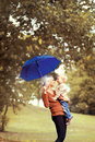 Happy mother and baby having fun in autumn Royalty Free Stock Photo
