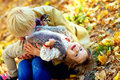 Happy mother and baby having fun in autumn park playful Stock Images