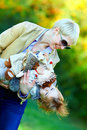 Happy mother and baby having fun in colorful park outdoors Royalty Free Stock Photos