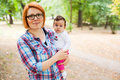 Happy mother with baby outdoors in a park Stock Images