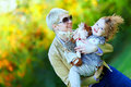 Happy mother and baby playing in colorful park spring Stock Image
