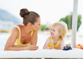 Happy mother and baby playing at poolside high resolution photo Royalty Free Stock Photos