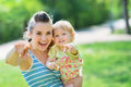 Happy mother and baby pointing in camera Royalty Free Stock Photo