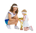 Happy mother and baby in tennis clothes with medal and goblet isolated on white Stock Photography