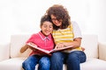 Happy mother and boy photo album looking at at home on sofa Stock Image