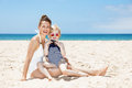 Happy mother and child at beach looking on photos in camera Royalty Free Stock Photo