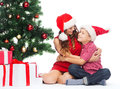 Happy mother and child boy with gift boxes holidays presents christmas x mas concept in santa helper hats Stock Images