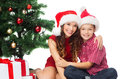 Happy mother and child boy with gift boxes holidays presents christmas x mas concept in santa helper hats Royalty Free Stock Image