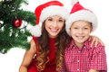 Happy mother and child boy in santa helper hats holidays presents christmas x mas concept Royalty Free Stock Images