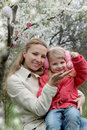 Happy mother and child with easter eggs in spring garden Stock Images
