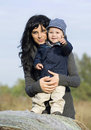 Happy mother and child in fall Royalty Free Stock Photography