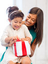 Happy mother and child girl with gift box holidays presents christmas x mas birthday concept Royalty Free Stock Photo