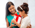 Happy mother and child girl with gift box holidays presents christmas x mas birthday concept Royalty Free Stock Photos