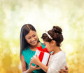 Happy mother and child girl with gift box holidays presents christmas x mas birthday concept Stock Image