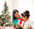 Happy mother and child girl with gift box holidays presents christmas x mas birthday concept Royalty Free Stock Image
