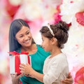 Happy mother and child girl with gift box holidays presents christmas x mas birthday concept Stock Photography