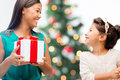 Happy mother and child girl with gift box holidays presents christmas x mas concept Royalty Free Stock Photo