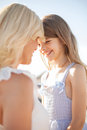 Happy mother and child girl summer holidays family children people concept Stock Images