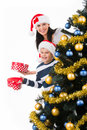 Happy mother with child hold box with gift near the christmas tree Stock Photography