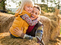 Happy mother and child hugging while on haystack portrait of Stock Image