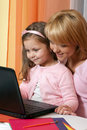 Happy mother and child with laptop Stock Photo
