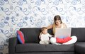 Happy mother and child with laptop at home Royalty Free Stock Images