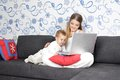 Happy mother and child with laptop at home Stock Photography
