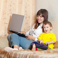 Happy mother and child with laptops Royalty Free Stock Images