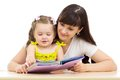 Happy mother and child read a book together reading Stock Image