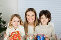 Happy mother and children with christmas gifts portrait of at home Royalty Free Stock Images