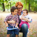 Happy mother with children in a park Royalty Free Stock Photos