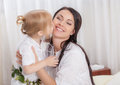 Happy Mother and daughter in bed Royalty Free Stock Photo