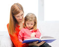 Happy mother and daughter with book Royalty Free Stock Image