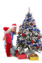 Happy mother and daughter over christmas tree 3 Royalty Free Stock Image