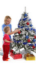 Happy mother and daughter over christmas tree 8 Royalty Free Stock Photos